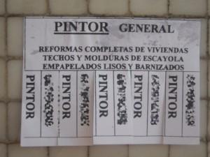 cartel de un anuncio de un pintor en Alicante.